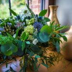 Foliage bouquet with blue flowers