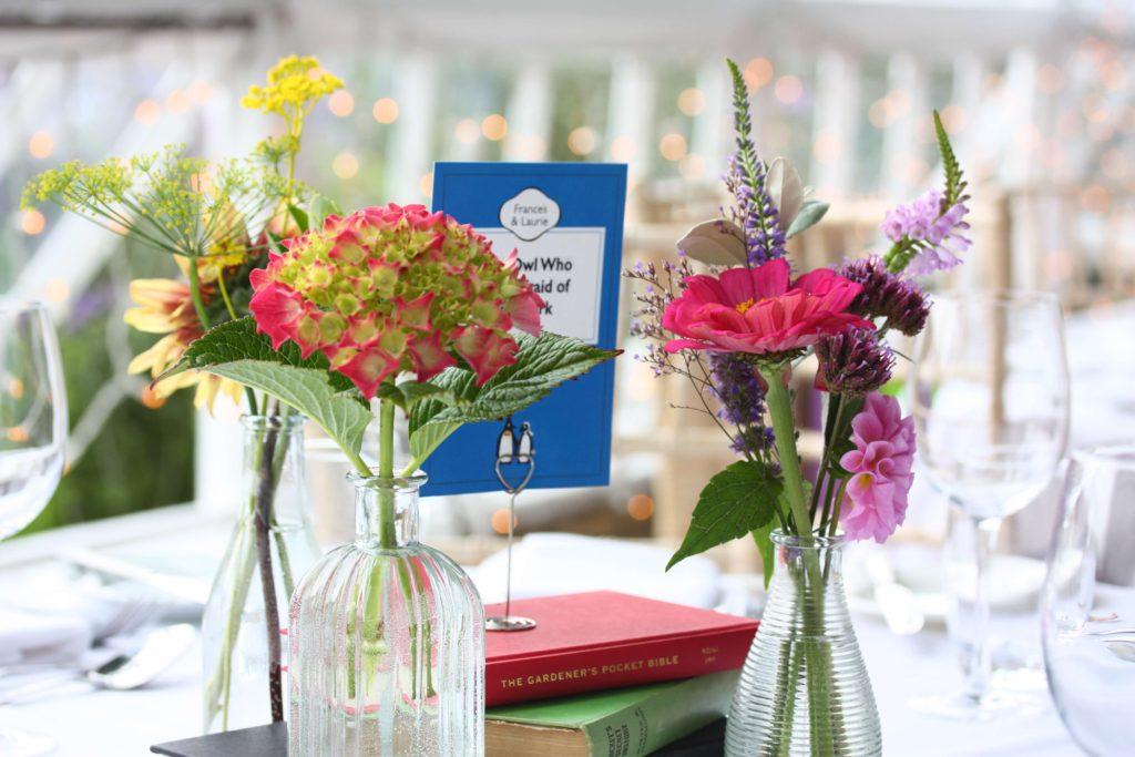 Flower bud vase and book tablecentre
