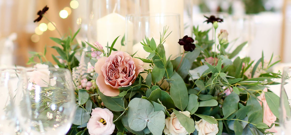 Wedding Table centrepiece at The Old Kent Barn.